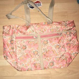 American Tourister pink paisley travel bag